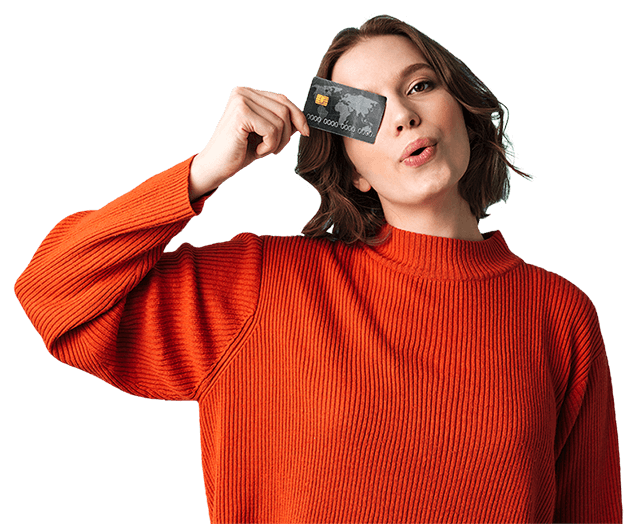 Woman Holding Up a Credit Card